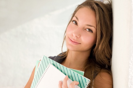 sexy school girl: End of summer, relaxed young student girl holding exercise books. Stock Photo