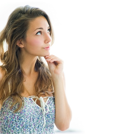 girl looking up: Thinkinf about - portrait of beautiful pondering brunette girl with copy space on white background.