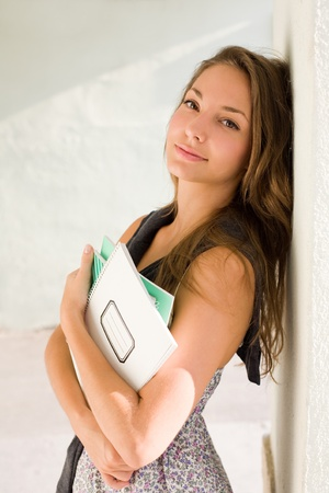 End of summer, back to school, portrait of beautiful friendly brunette student girl. photo