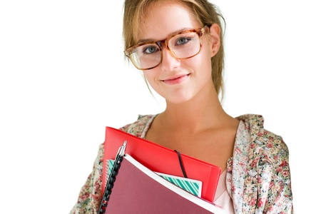Portraitof beautiful young student girl holding exercise books and folder isolated on white. Stock Photo - 10577360