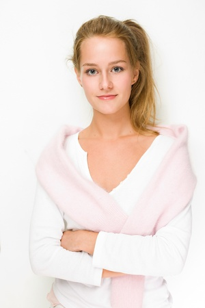 sweater girl: Portrait of fall fashion girl in white shirt and fluffy pink sweater.