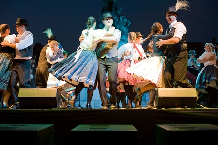 folk dancing: EGER - AUGUST 18: Traditional Hungarian folk dance performers on stage at night, as part of the St Sephen