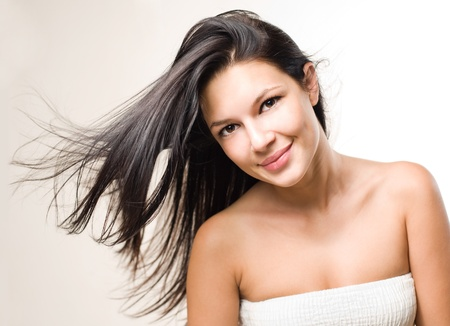 beauty shot: Dynamic beauty shot of gorgeous brunette with flowing hair.