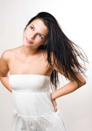 windblown: Tranquil beauty shot of gorgeous brunette with flowing hair.