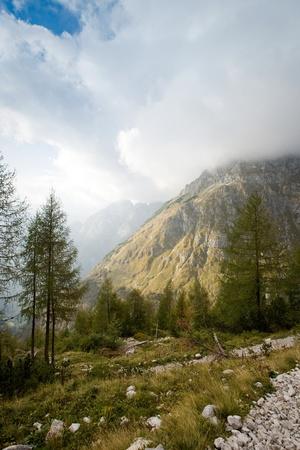follow through: Follow the path to Triglav through beautiful striking landscape scene to the highest peak in the Julian Alps. Stock Photo