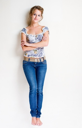 women jeans: Full length portrait of a friendly, fashionable confident young blond woman.