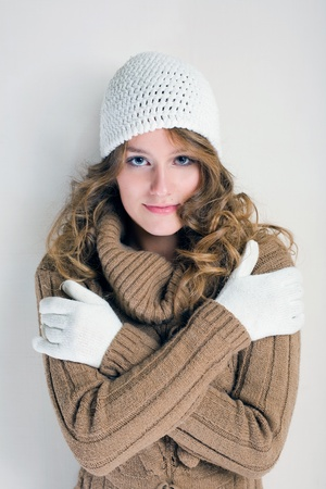 Portrait of cheerful winter fashion girl warming up for the cold season. photo