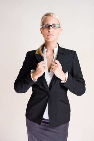 masculin: Portrait of Aggressive looking masculin posing business woman.
