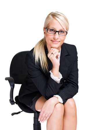 Portrait of friendly attractive blond business woman sitting in office chair isolated on white background. photo