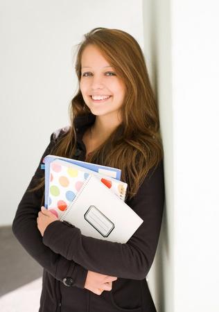 half  length: Half length portrait of fresh, cheerful young student girl. Stock Photo
