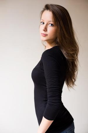 half  length: Half length portrait of attractive fit slender young brunette woman.