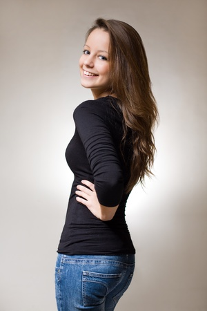 skinny people: Half length portrait of a fit slender young brunette Stock Photo