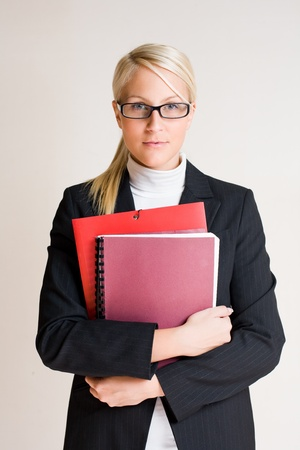 Half lenght portrait of tense looking young business woman. photo