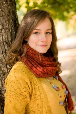 sweater girl: Outdoors portrait of beautiful colorful fall fashion woman.
