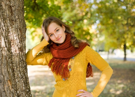 scarf: Half length portrait colorful fall fashion girl in the park. Stock Photo