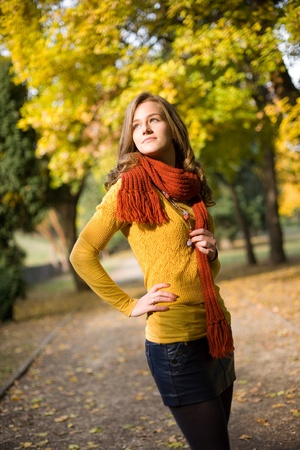 Half length portrait of dreamy fall fashion girl in colorful clothes. photo