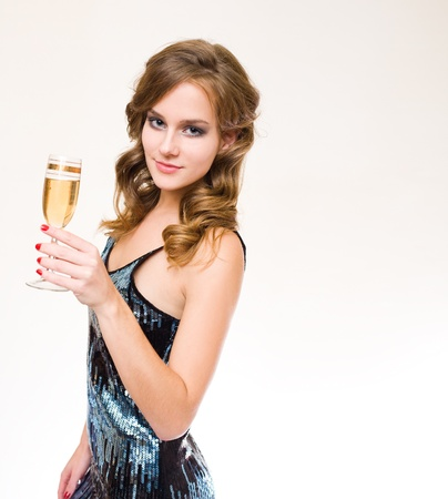 Half length portrait of beautiful young blond woman ready to celebrate photo