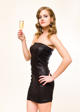 to tight: Half length portrait of beautiful young blond with champagne glass.