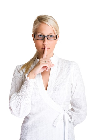 Can you keep a secret, beautiful young blond business woman making silence gesture isolated on white background. photo