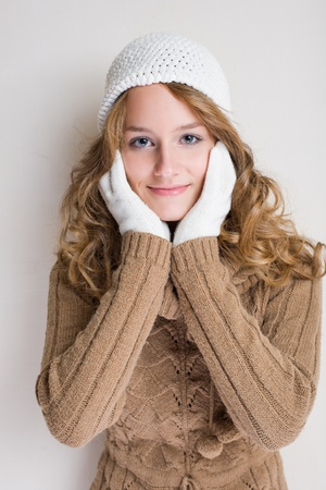 gloves women: Portrait of a fashionable young woman in winter outfit.