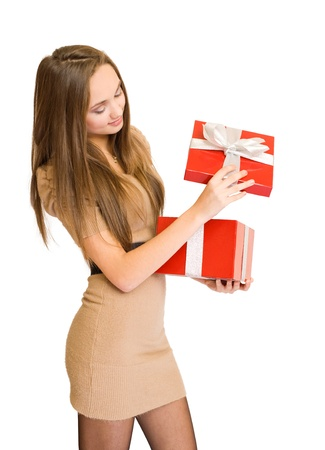 half  length: Half length portrait of gorgeous young brunette peeking inside shiny red gift box.