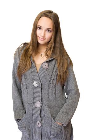 half  length: Half length portrait of beautiful brunette looking cute in big gray sweater.