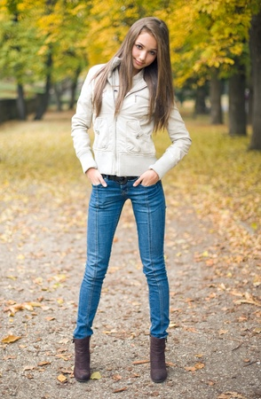 chilly: Beautiful young model dressed for chilly weather posing outdoors in the park.