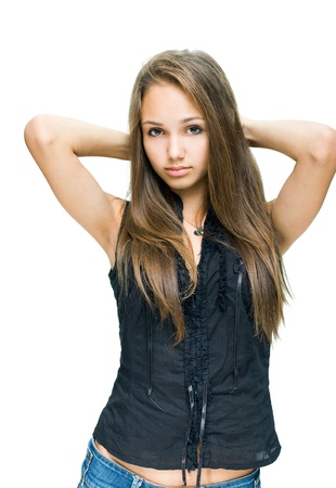 Half length portrait beautiful young brunette model in blue jeans and black top. photo