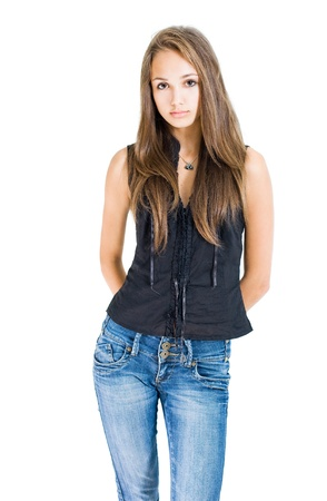 Portrait of fashionable young brunette model in blue jeans and black top. photo