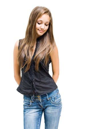 jeans girl: Portrait of a beautiful shy young brunette girl isolated on white background.