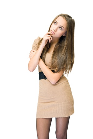 slender: Portrait of a beautiful young brunette girl in pondering gesture. Stock Photo