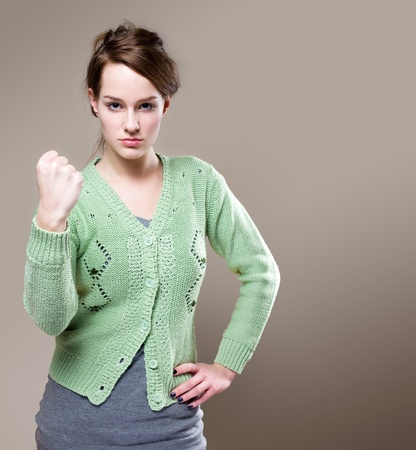 angry woman: Portrait of beautiful young brunette with very aggressive stance.