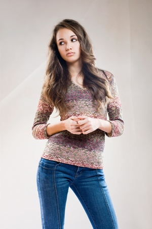 Portrait of a fashinalble beautiful young friendly brunette. photo