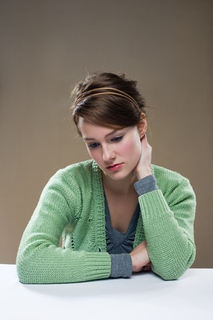 Portrait of a depressed looking young brunette woman. photo