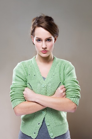 aggressive people: Half length portrait of an extremely aggressive looking young woman. Stock Photo