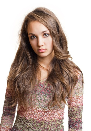 cute teen girl: Portrait of a striking beautiful young brunette girl with emotional facial expression.