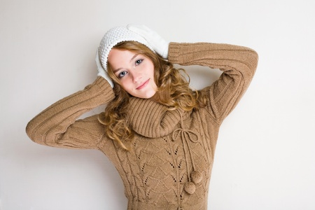 Gorgeous fashionable smiling young blond woman in pondering gesture. Stock Photo - 11959952