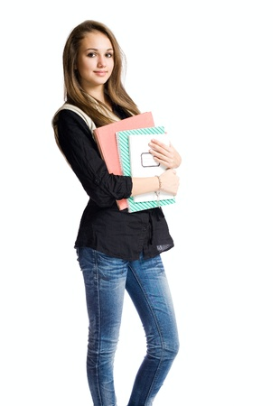 red jeans: Charming young student girl holding exercise books.
