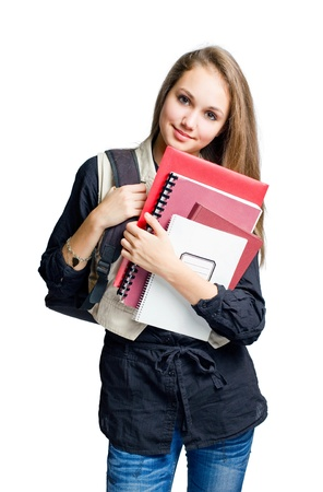 Charming young student girl holding exercise books. photo