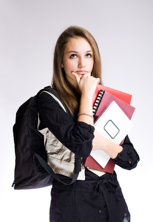 education choice: Gorgeous fashionable young student girl in pondering posture.
