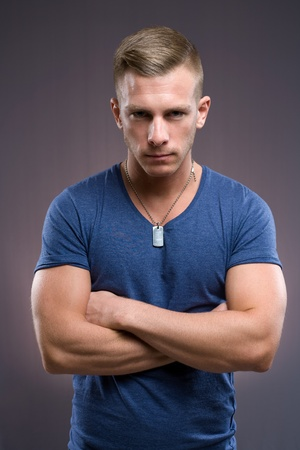 Portrait of masculine tough looking young man with serious expression and pose. photo