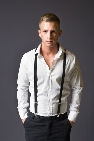 suspenders: Half length portrait of a young male fashion model. Stock Photo