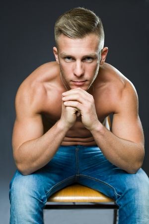 masculine: Your personal trainer, portrait of a very fit handsome young man.