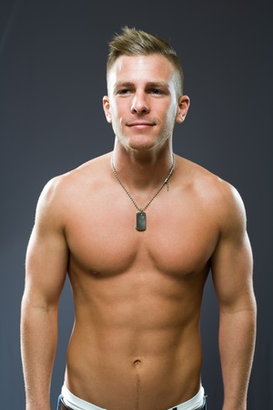 Portrait of a friendly smiling fit young man. Stock Photo - 12028530
