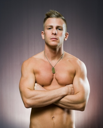 dark blond: Your personal trainer, portrait of a very fit handsome young man.