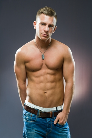 six pack abs: Half length portrait of a very fit, ripped young man.