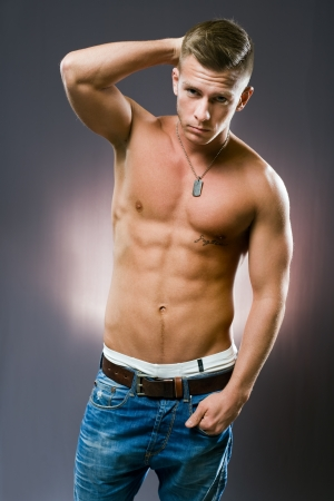 six pack: Half length portrait of a lean fit young man. Stock Photo