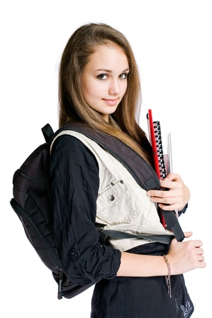 Portrait of a beautiful student girl with black backpack and books. photo
