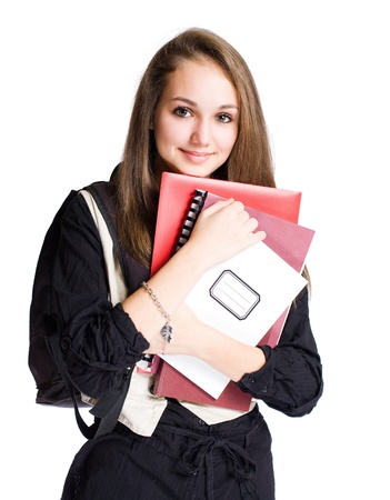 Portrait of a cute young brunette student girl with exercise books. photo