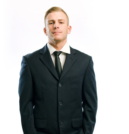 stance: Portrait of a proud young businessman isolated on white.